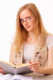 Beautiful young woman studying a book Royalty Free Stock Photo