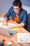 Beautiful young woman is studying with joy Royalty Free Stock Photography