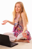 Beautiful young woman studying a laptop Royalty Free Stock Photos