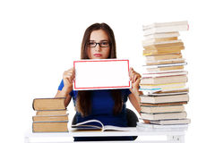 Beautiful young woman stuydent wih stack of books and holding co Stock Photos