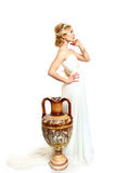 Beautiful young woman styled Greek with  amphora on white backgr Royalty Free Stock Photos