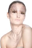 Beautiful young woman with stylezed facepaint Royalty Free Stock Photography