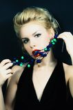Beautiful young woman with stylish hair and beads Stock Image
