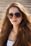 Beautiful young woman in stylish sunglasses Stock Images