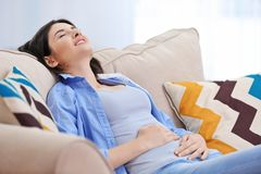 Beautiful young woman suffering from abdominal pain royalty free stock image