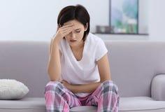 Beautiful young woman suffering from headache stock image