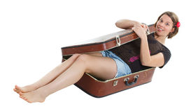 Beautiful young woman in suitcase Royalty Free Stock Photo