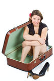 Beautiful young woman in suitcase Stock Image