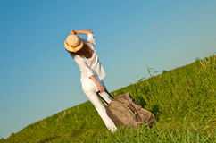 Beautiful young woman with a suitcase Stock Photography