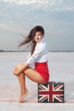 Beautiful young woman with suitcase with British flag outdoor Stock Photography