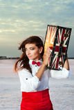 Beautiful young woman with suitcase with British flag outdoor Royalty Free Stock Photos