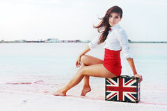 Beautiful young woman with suitcase with British flag outdoor Stock Photos