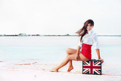 Beautiful young woman with suitcase with British flag outdoor Royalty Free Stock Images