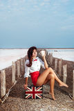Beautiful young woman with suitcase with British flag outdoor Royalty Free Stock Photography