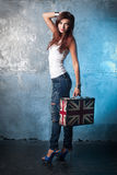 Beautiful young woman with suitcase with British flag Stock Image