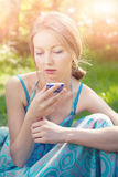 Beautiful young woman  in summer dress holding a cup of tea Royalty Free Stock Photos