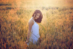 Beautiful young woman in a summer field Royalty Free Stock Image