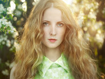 Beautiful young woman in summer garden Stock Images