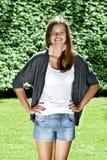 Beautiful young woman in the summer garden Stock Photos