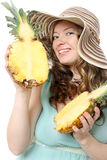 Beautiful young woman in summer hat. With pineapples isolated on white Royalty Free Stock Photography