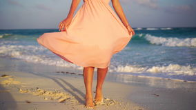 Beautiful young woman on summer holidays on white beach. Closeup female legs on the beach in the sunset. Beautiful vacation woman in sun smiling happy on summer stock video footage