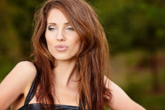Beautiful young woman in summer park. Royalty Free Stock Photography