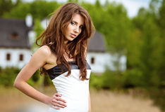 Beautiful young woman in summer park. Stock Images