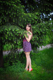 Beautiful young woman in a summer park outdoor portrait close up.  Stock Images