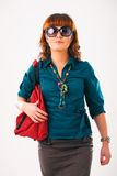 Beautiful young woman in sun glasses. Beautiful young woman in sunglasses with her shopping bags Stock Photography