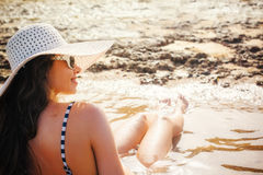 Beautiful young woman sunbathing on the beach Royalty Free Stock Photos