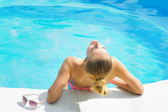 Beautiful young woman sunbathing rear view Royalty Free Stock Images