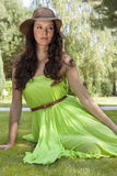 Beautiful young woman in sundress relaxing in park Stock Images