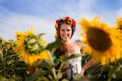 Beautiful young woman with sunflower Stock Images