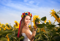 Beautiful young woman with sunflower Royalty Free Stock Photos