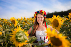 Beautiful young woman with sunflower Royalty Free Stock Images