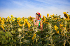 Beautiful young woman at sunflower field Royalty Free Stock Images