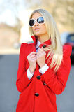 Beautiful young woman in sunglasses. Posing outdoors royalty free stock image