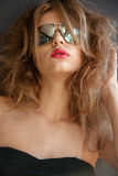 Beautiful young woman in sunglasses Royalty Free Stock Photography