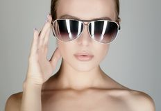 Beautiful young woman in sunglasses Stock Image