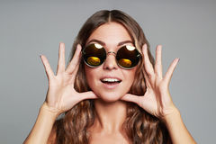 Beautiful young woman in sunglasses.funny smile Stock Photo