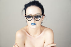 Beautiful young woman in sunglasses on gray background Royalty Free Stock Photos