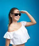 Beautiful young woman in sunglasses looking into the distance Royalty Free Stock Images