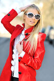 Beautiful young woman in sunglasses outdoors. Beautiful young woman in sunglasses posing outdoors stock images