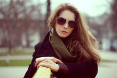 Beautiful young woman in sunglasses resting Royalty Free Stock Images