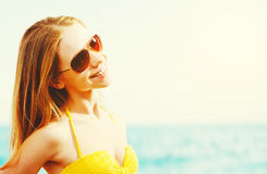 Beautiful young woman in sunglasses summer  beach. Beautiful young woman in sunglasses summer sea beach Royalty Free Stock Image
