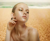 Beautiful young woman on the sunny beach Royalty Free Stock Photos