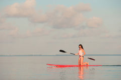 Beautiful young woman surfing on stand up paddle Royalty Free Stock Photo