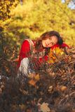 Beautiful young woman in sweater in autumn park Stock Photos