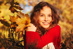 Beautiful young woman in sweater in autumn park Stock Photo