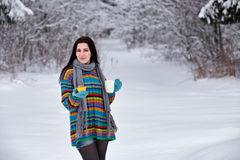 Beautiful young woman in a sweater. Winter outdoors walk with a. Cup of coffee Stock Photo
